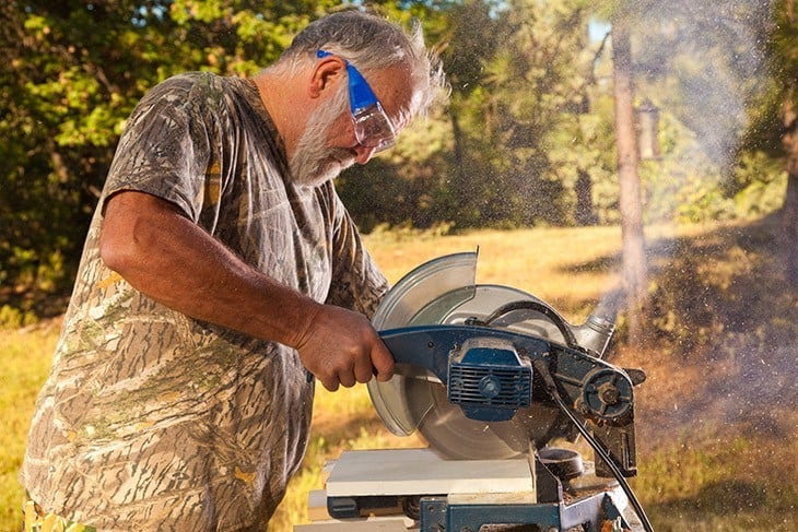 Man operating a chop saw