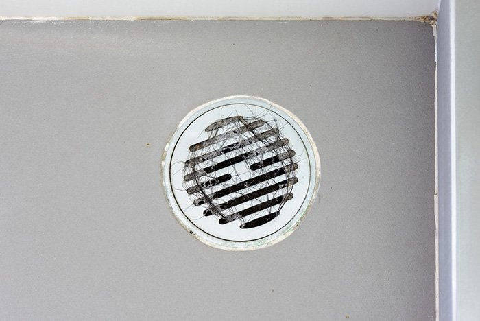 shower drain cover hair stuck
