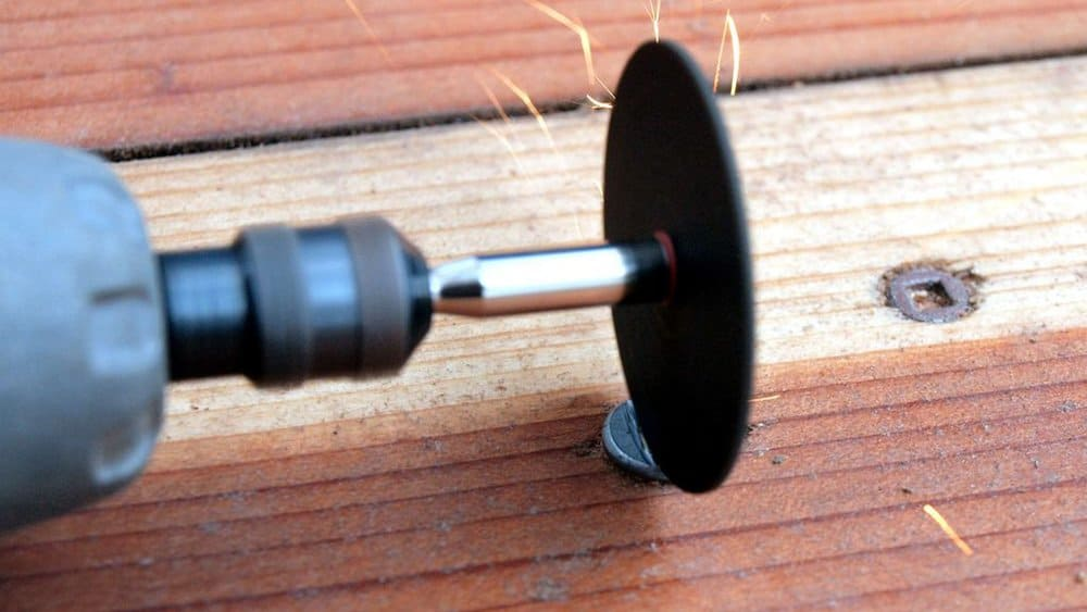 remove a damaged screw using grinding tool